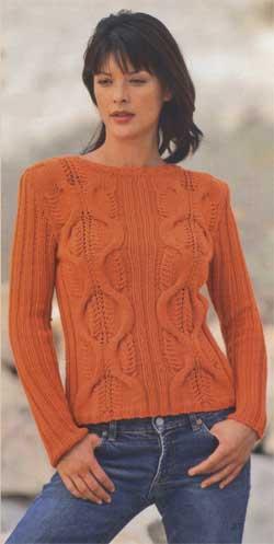Оранжевый пуловер с косами